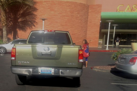 A man drops his wife off at the Palms Casino Resort, with a license plate educating his followers about a key tenet of responsible gaming.